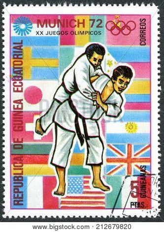 EQUATORIAL GUINEA - CIRCA 1972: A stamp printed in Equatorial Guinea devoted to the Summer Olympics 1972 Munich shows a sports disciplines - Judo circa 1972
