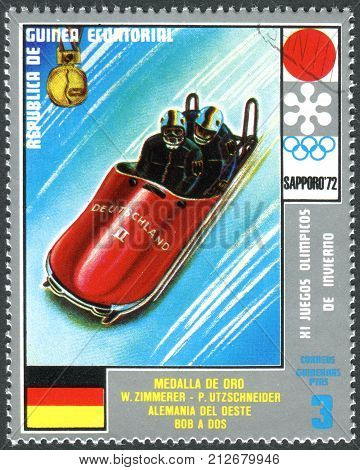 EQUATORIAL GUINEA - CIRCA 1972: A stamp printed in Equatorial Guinea shows the Wolfgang Zimmerer and Peter Utzschneider - Medalists of the Winter Olympics 1972 Sapporo circa 1972