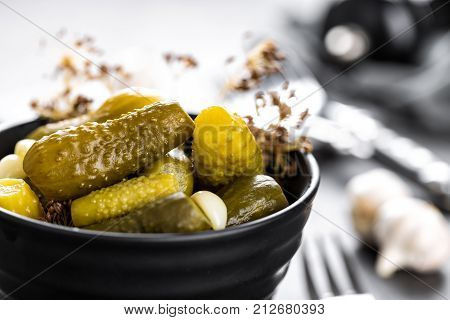 Pickled cucumbers, small marinated pickles, gherkins closeup