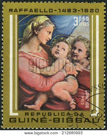 GUINEA - BISSAU - CIRCA 1983: A stamp printed in Guinea-Bissau shows a painting of Madonna della tenda by Raphael a collection of Alte Pinakothek in Munich circa 1983