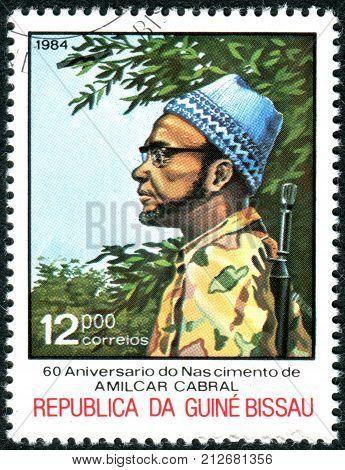 GUINEA - BISSAU - CIRCA 1984: A stamp printed in Guinea-Bissau dedicated to 60th Anniversary of Birth Amilcar Cabral shows the Amilcar Cabral in combat fatigues circa 1984