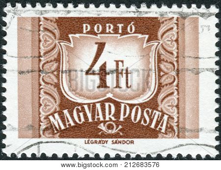 HUNGARY - CIRCA 1969: Postage stamp (dues) printed in Hungary shows a figure - value on the heraldic coat of arms circa 1969