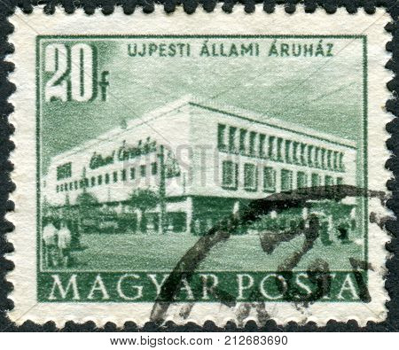 HUNGARY - CIRCA 1953: Postage stamp printed in Hungary shows a Department store in Ujpest circa 1953