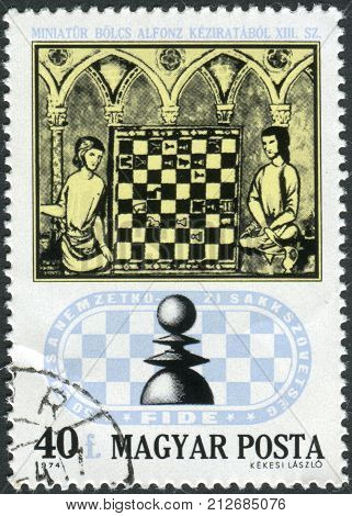 HUNGARY - CIRCA 1974: Postage stamp printed in Hungary devoted to 50th Anniversary of the International Chess Federation shows Chess Players from 15th Century Manuscript circa 1974