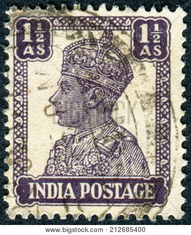INDIA - CIRCA 1942: A stamp printed in India shows the King George VI circa 1942