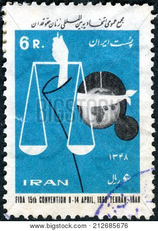 IRAN - CIRCA 1969: A stamp printed in Iran dedicated to the 15th FIDA (Female Jurists) Convention Teheran shows Scales of Justice and Blindfold Globe circa 1969