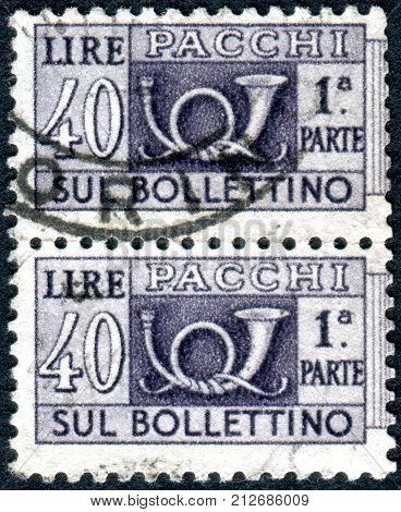 ITALY - CIRCA 1957: Parcel post stamp printed in Italy shows the traditional post horn and face value circa 1957