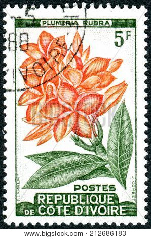 IVORY COAST - CIRCA 1962: A stamp printed in Ivory Coast shows flower Plumeria rubra circa 1962