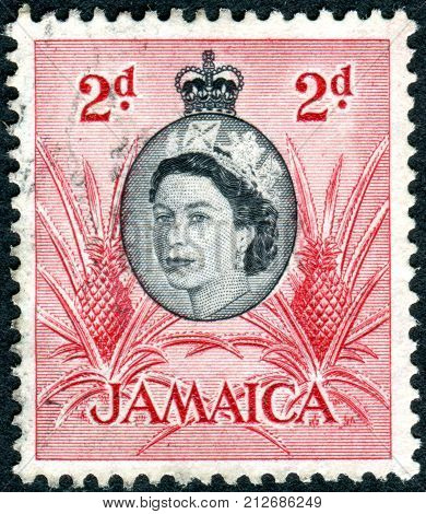 JAMAICA - CIRCA 1956: Postage stamp printed in Jamaica shows a portrait of Queen Elizabeth II and Pineapple circa 1956