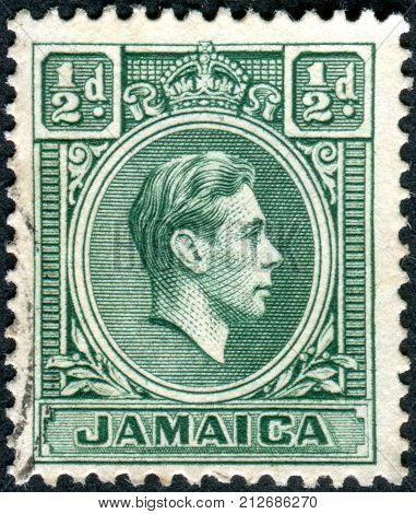 JAMAICA - CIRCA 1938: Postage stamp printed in Jamaica shows a portrait of King George VI circa 1938