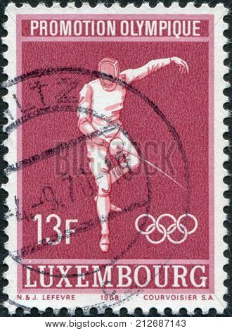 LUXEMBOURG - CIRCA 1968: A stamp printed in Luxembourg is dedicated to summer Olympic Games in Mexico is shown Fencing circa 1968