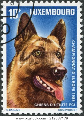 LUXEMBOURG - CIRCA 1983: A stamp printed in Luxembourg, is dedicated to European Working Dog Championship, shows Shepherd Dog, circa 1983