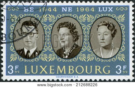LUXEMBOURG - CIRCA 1964: A stamp printed in Luxembourg is dedicated to 20th anniversary of the customs union of Belgium Netherlands and Luxembourg shows King Baudouin Queen Juliana and Grand Duchess Charlotte circa 1964