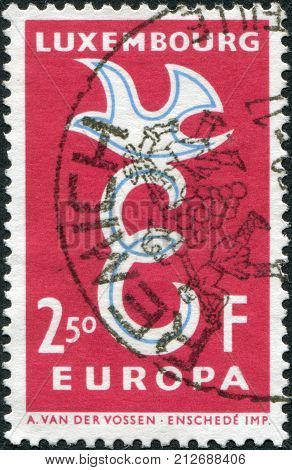 LUXEMBOURG - CIRCA 1958: A stamp printed in Luxembourg European Postal Union at the service of European integration shows