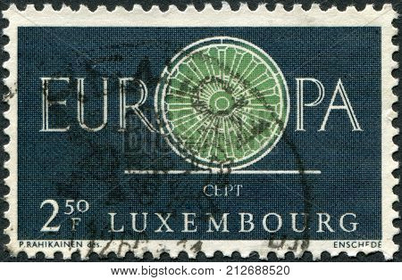 LUXEMBOURG - CIRCA 1960: A stamp printed in Luxembourg shows the word EUROPE the letter O as a bicycle wheel with 19 spokes circa 1960