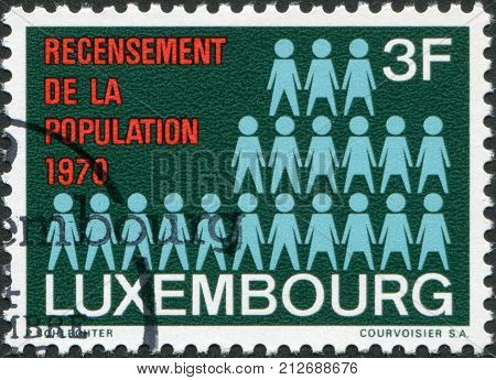LUXEMBOURG - CIRCA 1970: A stamp printed in Luxembourg is devoted to census shows number of pieces - a symbol of the census circa 1970