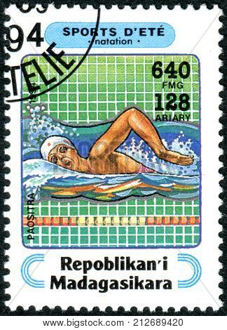 MADAGASCAR - CIRCA 1994: A stamp printed in Madagascar shows the swimming circa 1994