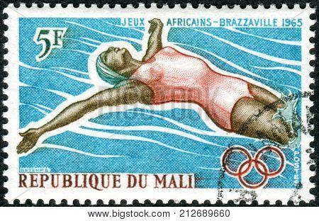 MALI - CIRCA 1965: A stamp printed in Mali shows a Cattle Herd (Bos primigenius taurus) circa 1965