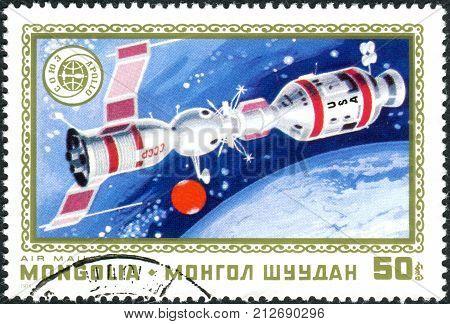 MONGOLIA - CIRCA 1975: A postage stamp printed in Mongolia shows the docking of spacecraft Soyuz - Apollo circa 1975
