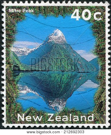 NEW ZEALAND - CIRCA 1995: A stamp printed in New Zealand shows Mitre Peak circa 1995