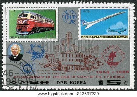NORTH KOREA - CIRCA 1986: Postage stamp printed in North Korea dedicated to 40th Anniversary of the issue of stamp of the DPR Korea shows a diesel locomotive Kumsong and airplane Aerospatiale-BAC Concorde circa 1986