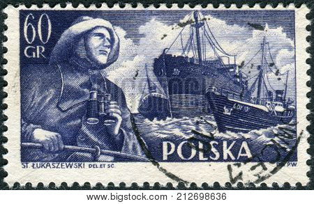 POLAND - CIRCA 1956: Postage stamp printed in Poland shows a Fisherman SSChopin and trawlers circa 1956