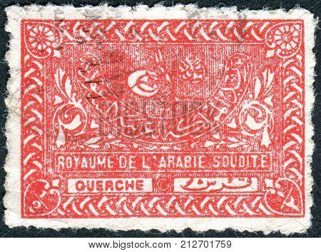 SAUDI ARABIA - CIRCA 1943: Postage stamp printed in Saudi Arabia shows the Tughra of King Abdul Aziz circa 1943