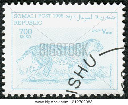SOMALIA - CIRCA 1998: A stamp printed in Somalia shows the animal Leopard (Panthera pardus) circa 1998