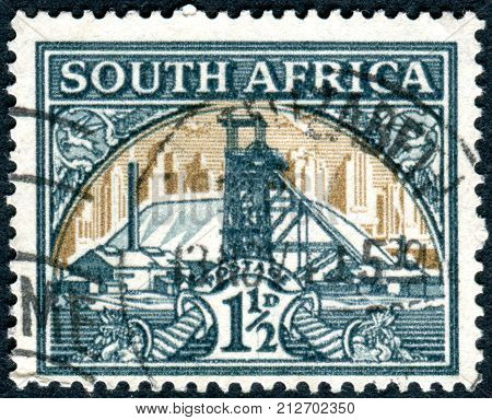 SOUTH AFRICA - CIRCA 1936: Postage stamp printed in South Africa shows Gold Mine circa 1936