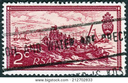SOUTH AFRICA - CIRCA 1971: A stamp printed in South Africa dedicated to 10th anniversary of the Republic of South Africa is depicted Landing of British Settlers 1820 by Thomas Baines circa 1971