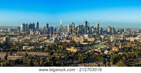 AUSTRALIA MELBOURNE - APRIL 4 2016: Melbourne Skyline with Carlton cemetery and Melbourne University in foreground
