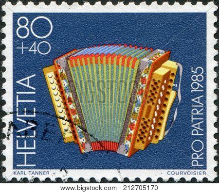 SWITZERLAND - CIRCA 1985: A stamp printed in Switzerland shows a folk instrument Diatonic accordion 20th century circa 1985