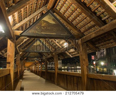 SWITZERLAND LUCERNE - MARCH 19 2015: Inside view of Chapel Bridge in Lucern Switzerland