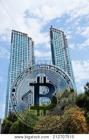 Bitcoin against the background of the building under construction business center. Double exposure. The concept of growth and development of virtual business. The concept of interweaving virtual and real business.