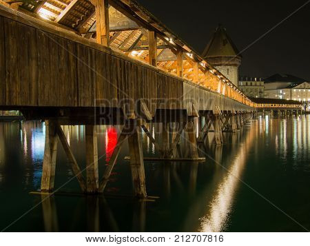 SWITZERLAND LUCERNE - MARCH 19 2015: Night shot the of Chapel Bridge in City of Lucern Switzerland