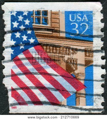 USA - CIRCA 1995: Postage stamps printed in USA shows the USA national flag over Porch circa 1995