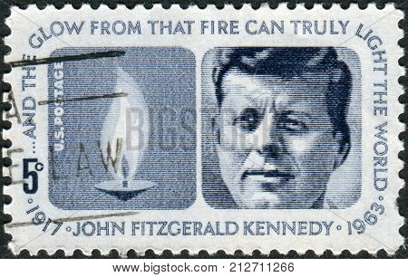 USA - CIRCA 1964: Postage stamp printed in the USA a portrait of 35th President of the United States John Fitzgerald Kennedy and Eternal Flame circa 1964