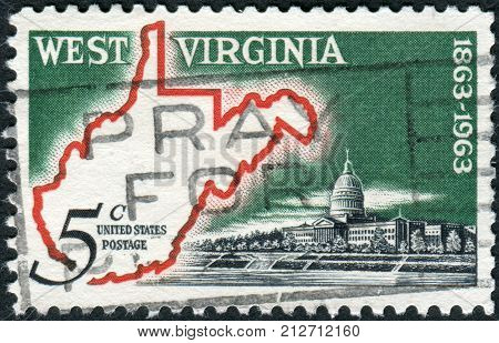 USA - CIRCA 1963: A postage stamp printed in the USA is dedicated to West Virginia Statehood Centenary shows Map of West Virginia & State Capitol circa 1963
