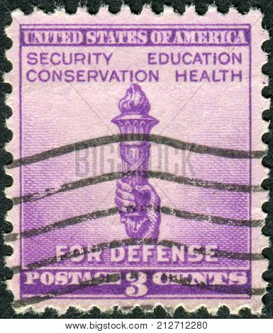 USA - CIRCA 1940: Postage stamp printed in the USA National Defense Issue shows Torch of Enlightenment circa 1940