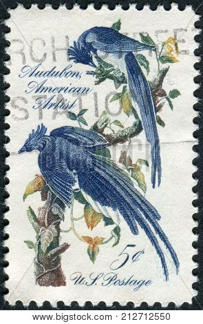 USA - CIRCA 1963: A postage stamp printed in the USA John J. Audubon Issue shows Columbia Jays by design is from a mural by Howard Pyle circa 1963