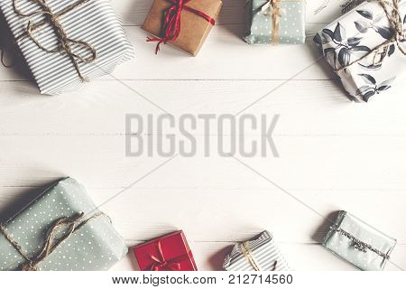 Christmas Flat Lay. Wrapped Present Boxes On White Wooden Background Top View, Space For Text.  Seas