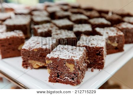chocolate cakes with nuts on a white plate
