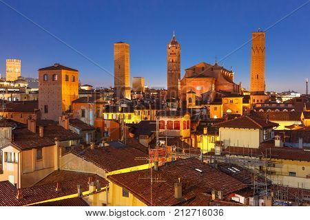 Aerial view of Bologna Cathedral and towers towering above of the roofs of Old Town in medieval city Bologna during evening blue hour, Emilia-Romagna, Italy
