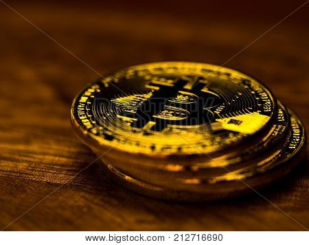Golden bitcoin cryptocurrency banking money transfer business technology on wooden table. Concept of distributed ledger technology and digital electronic binary money financial.