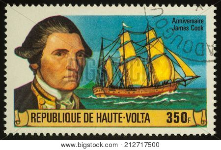 Moscow Russia - November 07 2017: A stamp printed in Upper Volta shows Captain James Cook and his ship