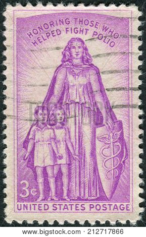 USA - CIRCA 1957: Postage stamp printed in the USA Honoring those who helped fight polio and 20th anniv. of the Natl. Foundation for Infantile Paralysis and the March of Dimes circa 1957