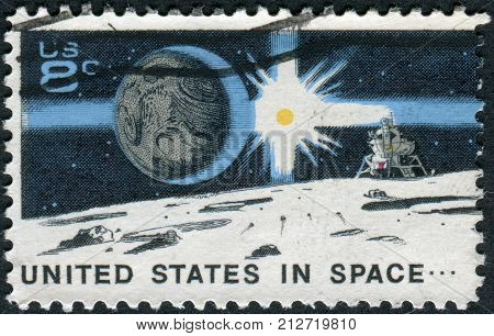 USA - CIRCA 1971: A postage stamp printed in USA Space Achievement Decade Issue shows the Earth Sun Landing Craft on Moon circa 1971
