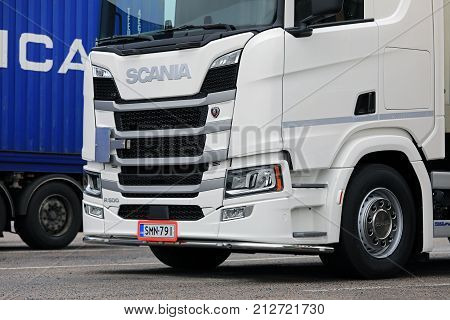 SALO FINLAND - NOVEMBER 5 2017: White Next Generation Scania R500 truck parked on the asphalt yard of a truck stop.