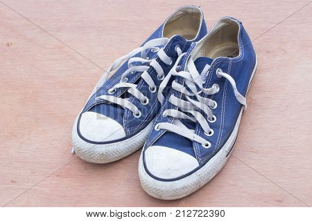 Pars Of Canvas  Blue Shoes On The Wood Background , Dirty Blue Shoes