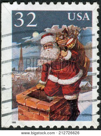Usa - Circa 1995: Postage Stamp Printed In Usa, Christmas Issue, Shows Santa Claus Entering Chimney,